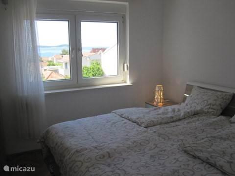 Slaapkamer 1. met prachtig uitzicht op zee