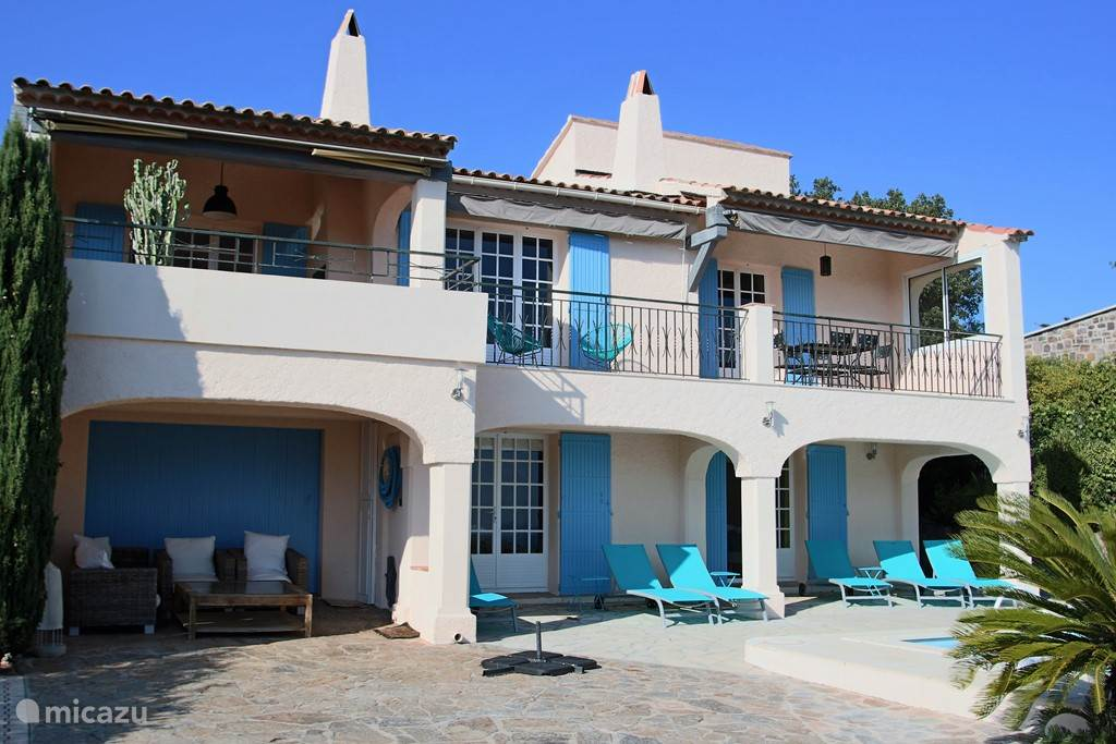 Front with sun loungers and pool