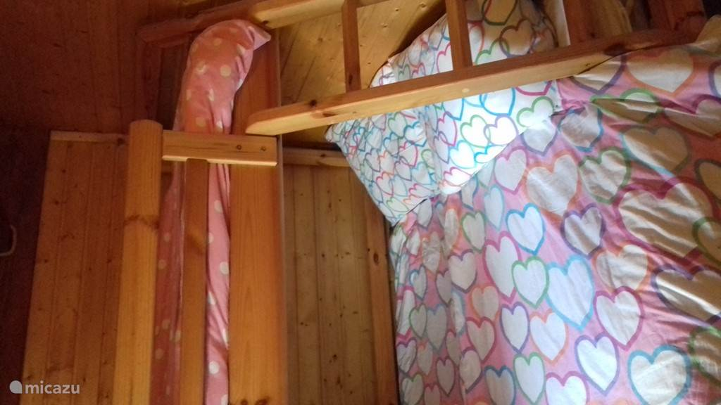Bedroom with 3-person bunk bed.