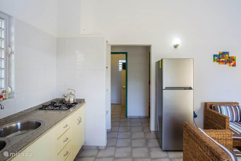 Doorkijk from living room to bathroom and bedrooms