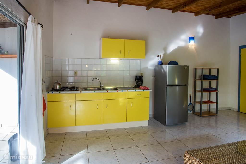 Living rooms with kitchenette apartments Wabi and Mahok
