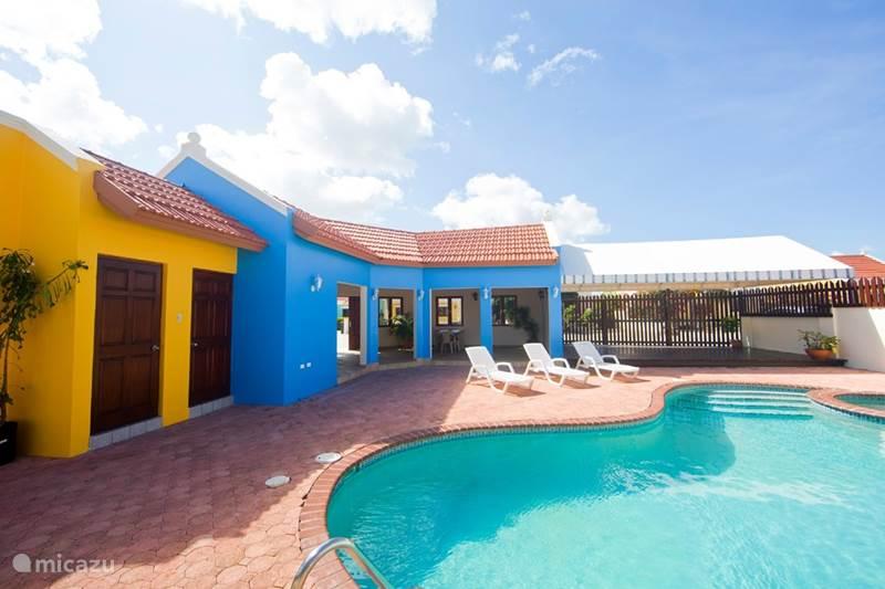 Vakantiehuis Aruba, Noord, Palm Beach Appartement Luxe apartment met zwembad toegang