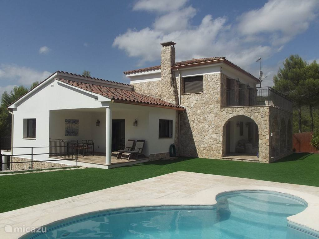 Huis met tuin en zwembad