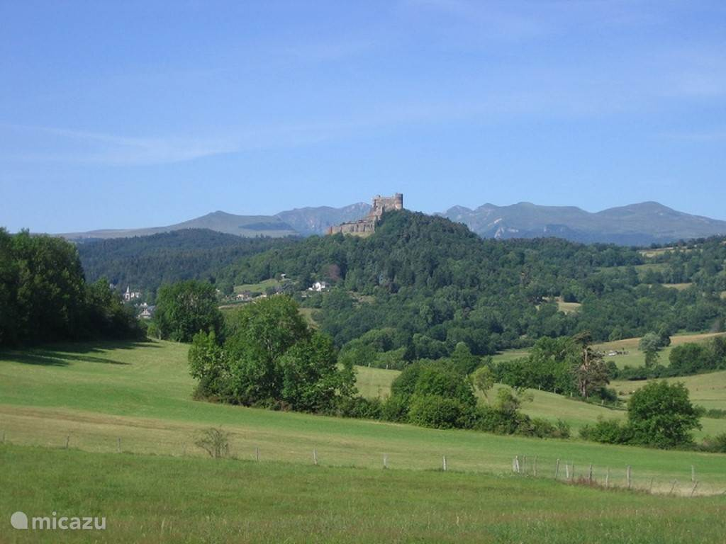 View at Sapchat with Murol castle and the Sancy Mountains