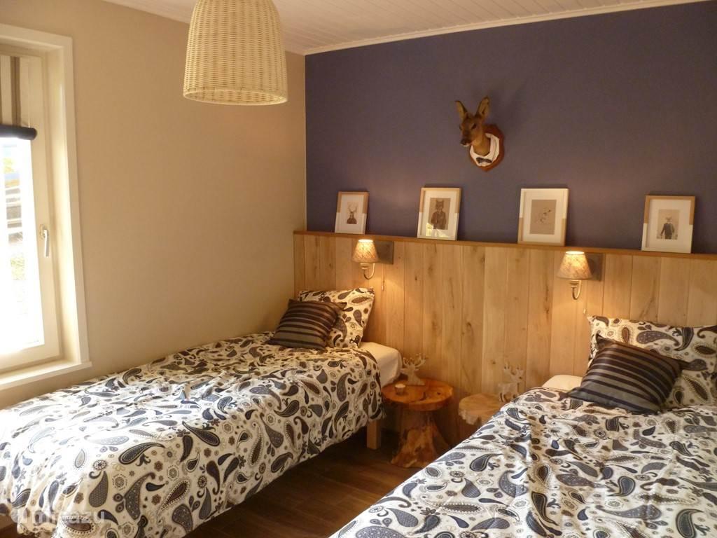 Tweede slaapkamer met twee enkel bedden