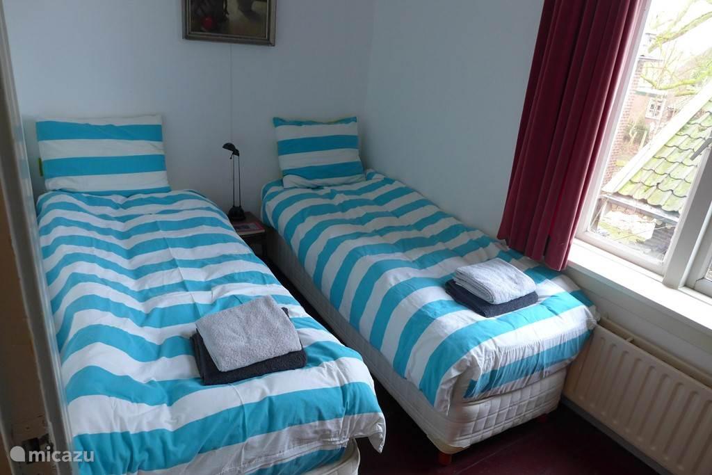 Slaapkamer 1e verd.