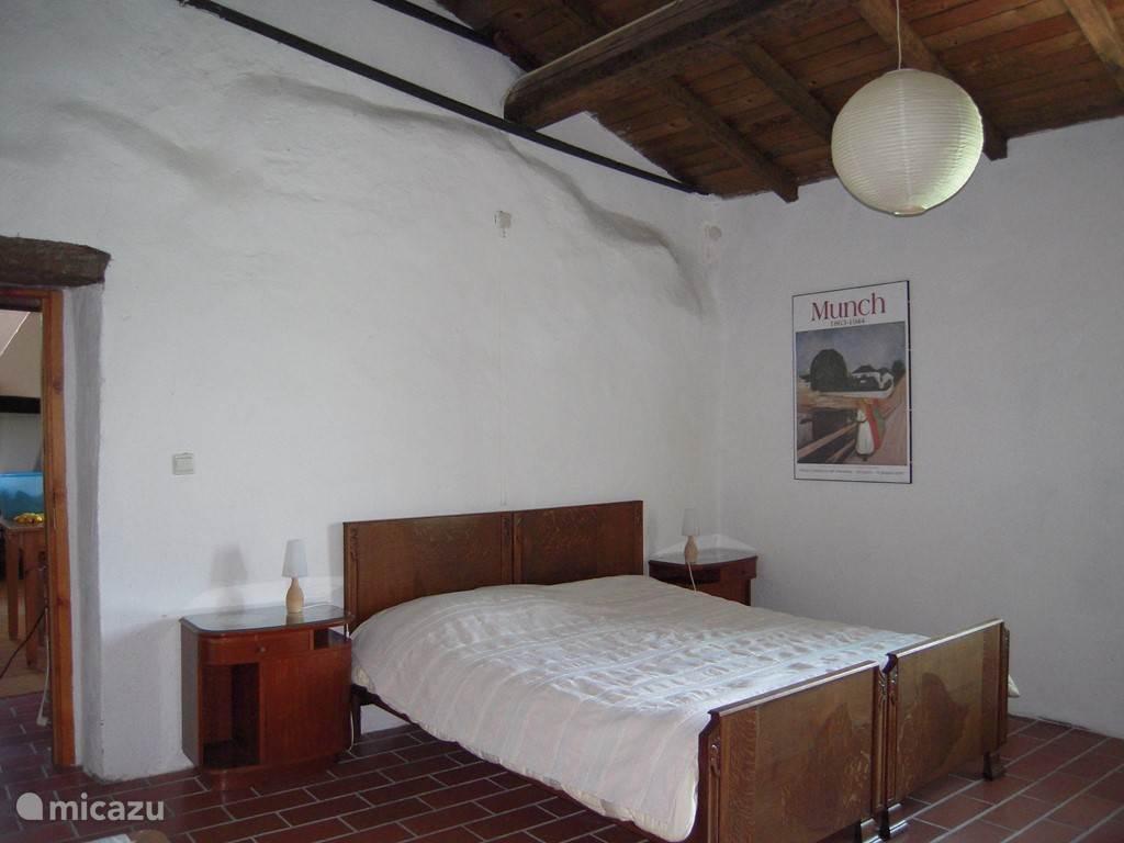 Slaapkamer met litsjumeaux