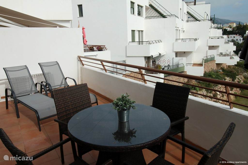Terrace with sun beds