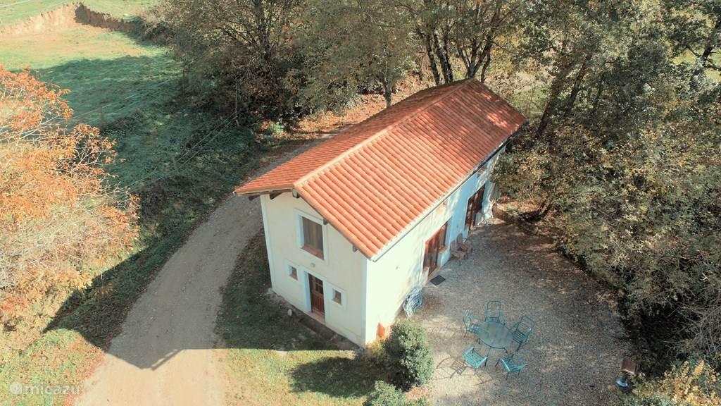 La Maisonnette van bovenaf gezien, in de herfst