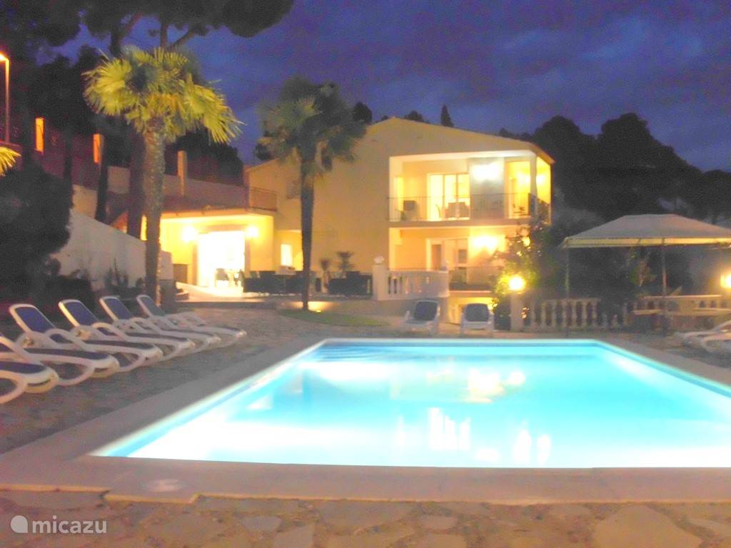 Night photo of villa tropicana