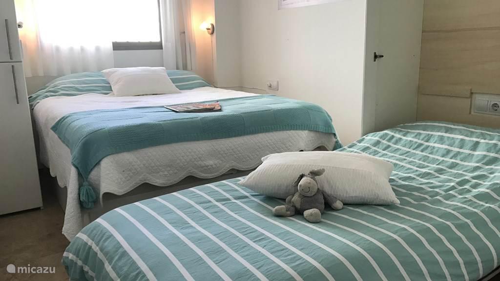 Een extra bed in de slaapkamer