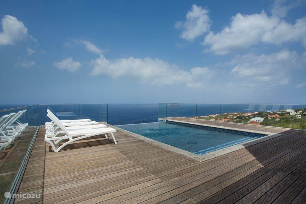 Private pool with loungers, overlooking the Caribbean Ocean