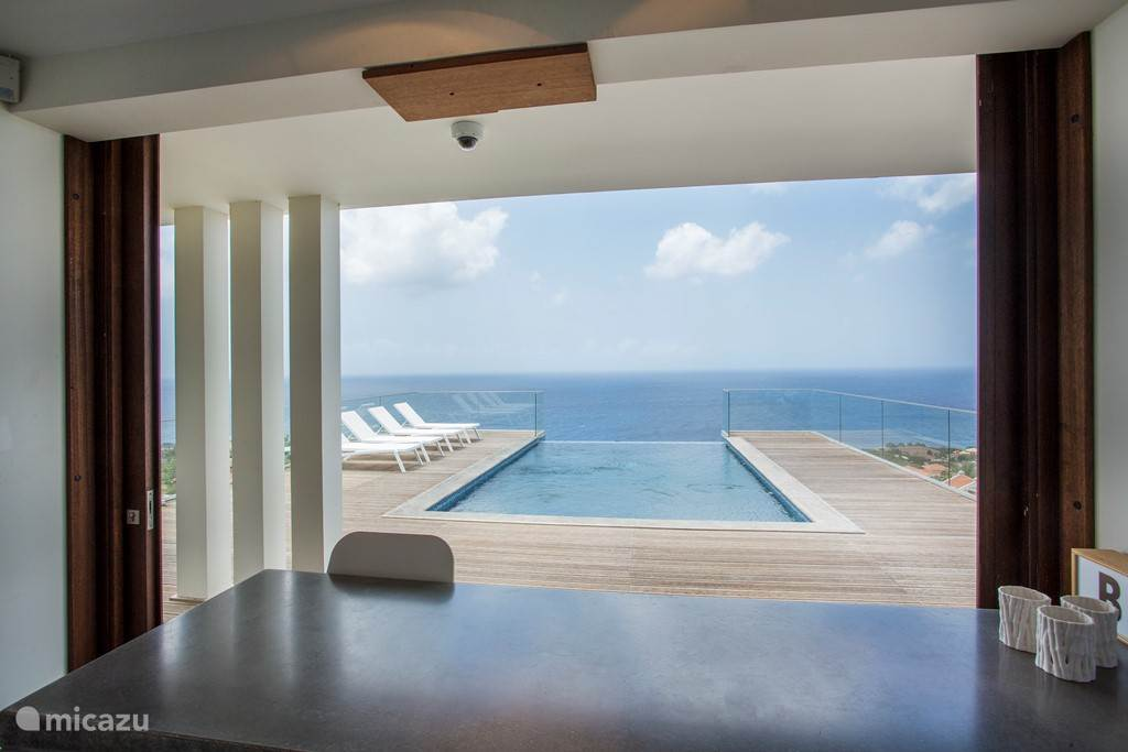 View from kitchen, overlooking pool and ocean