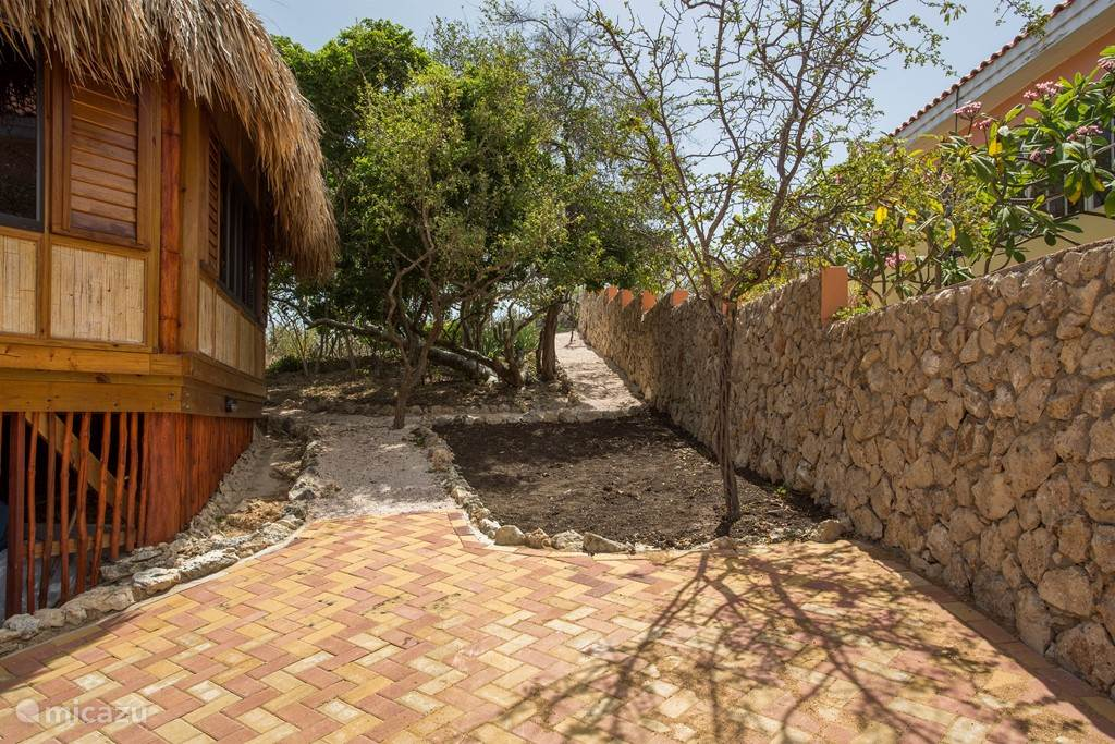 Parking lot and entrance palapa house.