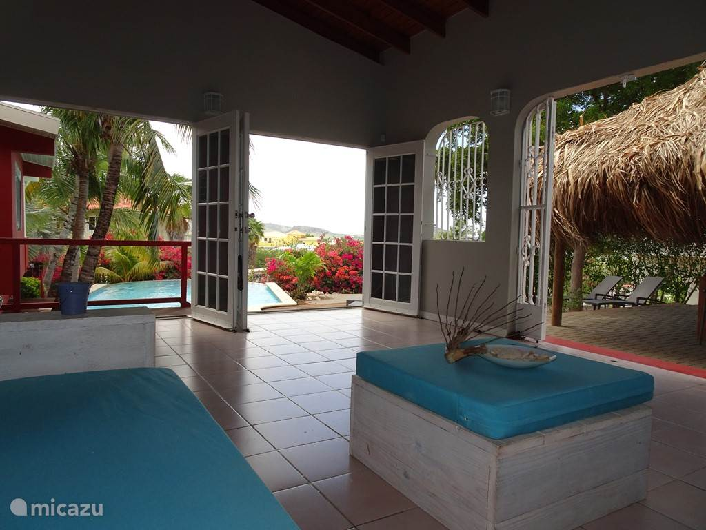Porch overlooking pool and spa waters