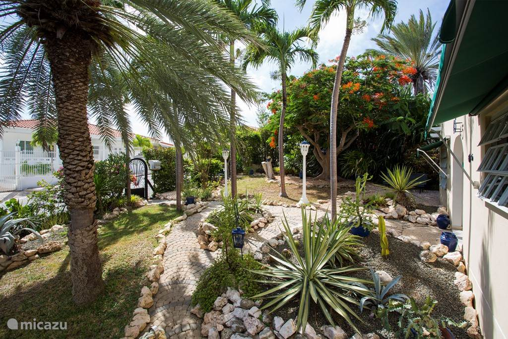 A lush tropical garden surrounds this villa.