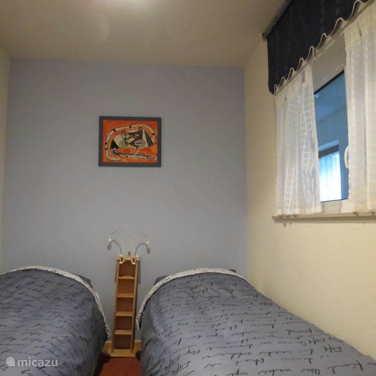 slaapkamer 1 met 2 een-persoonsbedden
