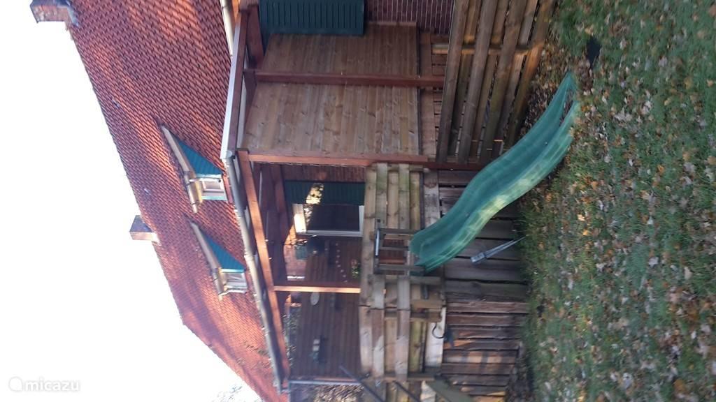 veranda met glijbaan
