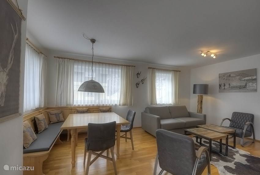 From the spacious corridor you enter the cosy and roomy living room with a typical austrian dining corner. There is an open kitchen with all equipment needed to make your stay as comfortable as possible.