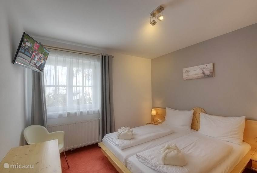 The apartment has two beautiful, spacious,  comfortably decorated bedrooms with large closets. They both have a television. There is one large bathroom with a bath tub. The toilet is separate and this apartment has it's own washing machine.