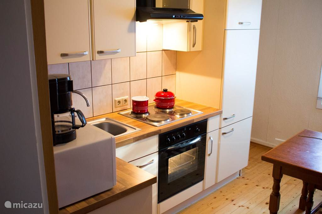 Fully equipped kitchen with oven, dishwasher, microwave etc.