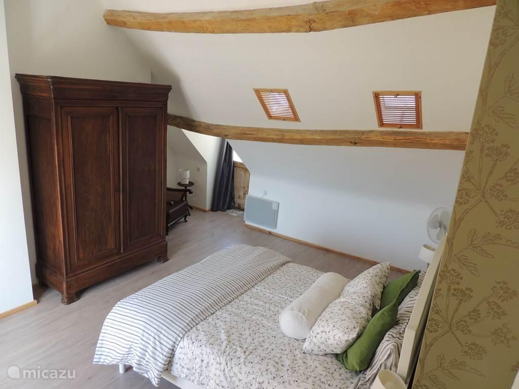 Grootste slaapkamer met openslaande deuren naar dakterras
