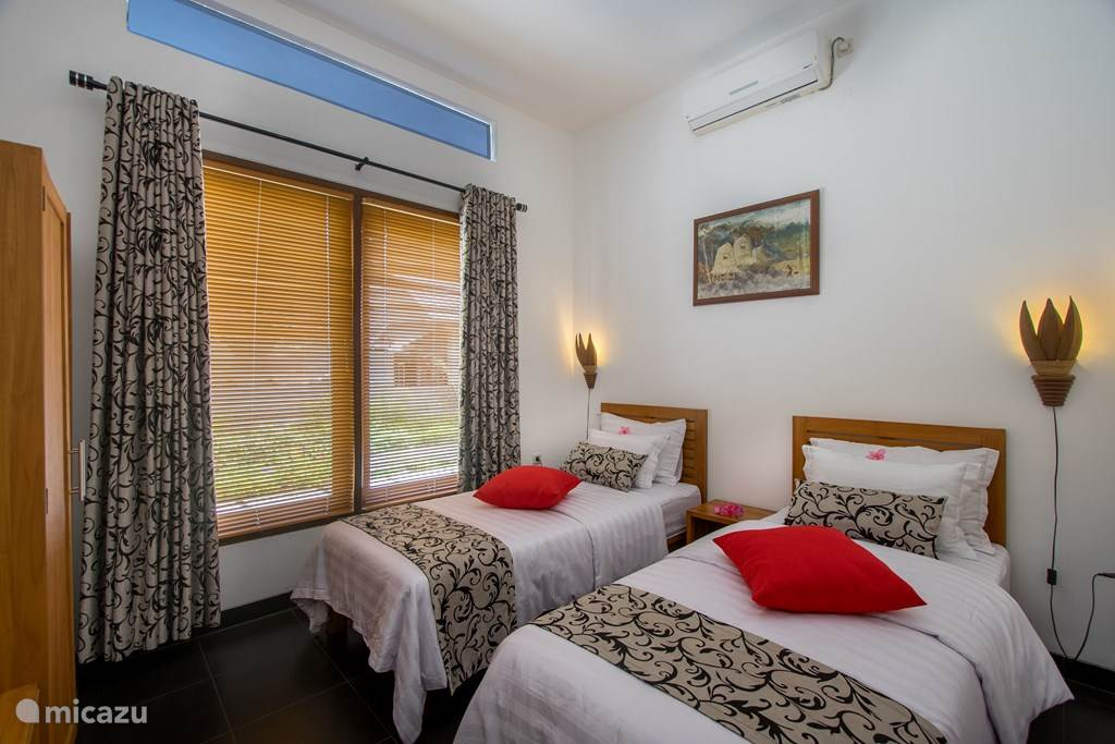 Slaapkamer met 2 single bed