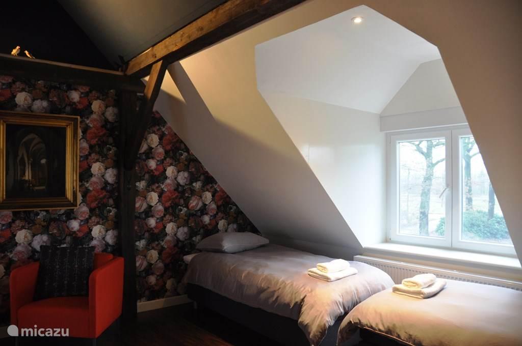 Slaapkamer op 1e verdieping met 4 bedden
