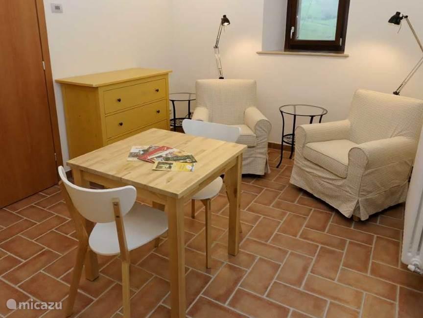 Zitkamer appartement Giallo