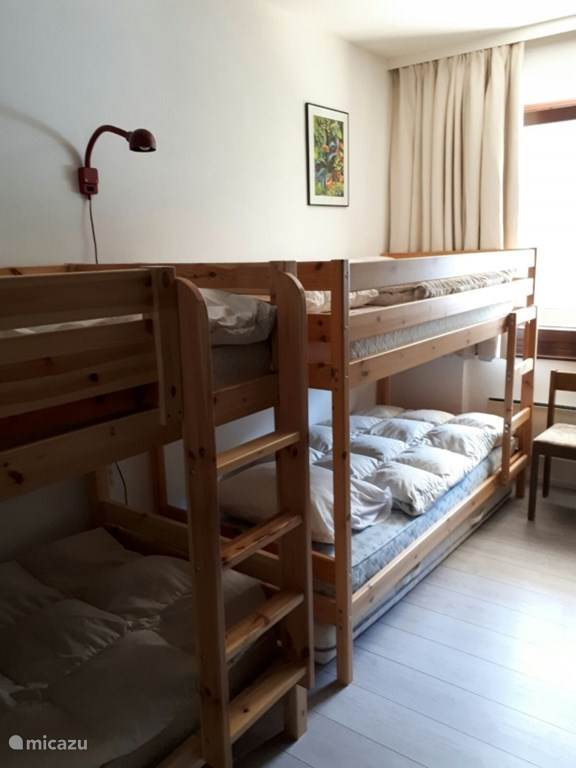 The bedroom with 2 double bunk beds.