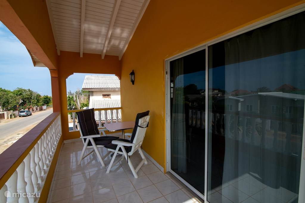 Spacious balcony with seating