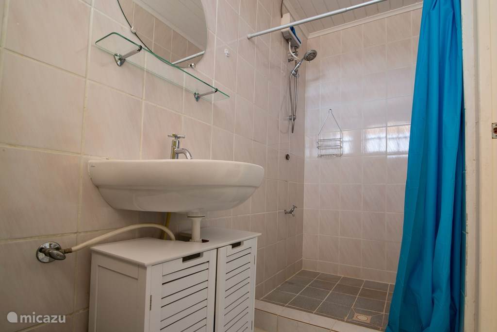 Bathroom at bedroom with double bed