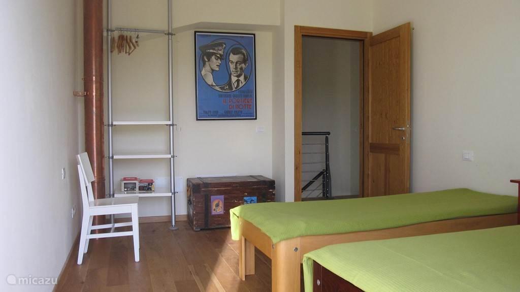 Slaapkamer van een van de appartementen