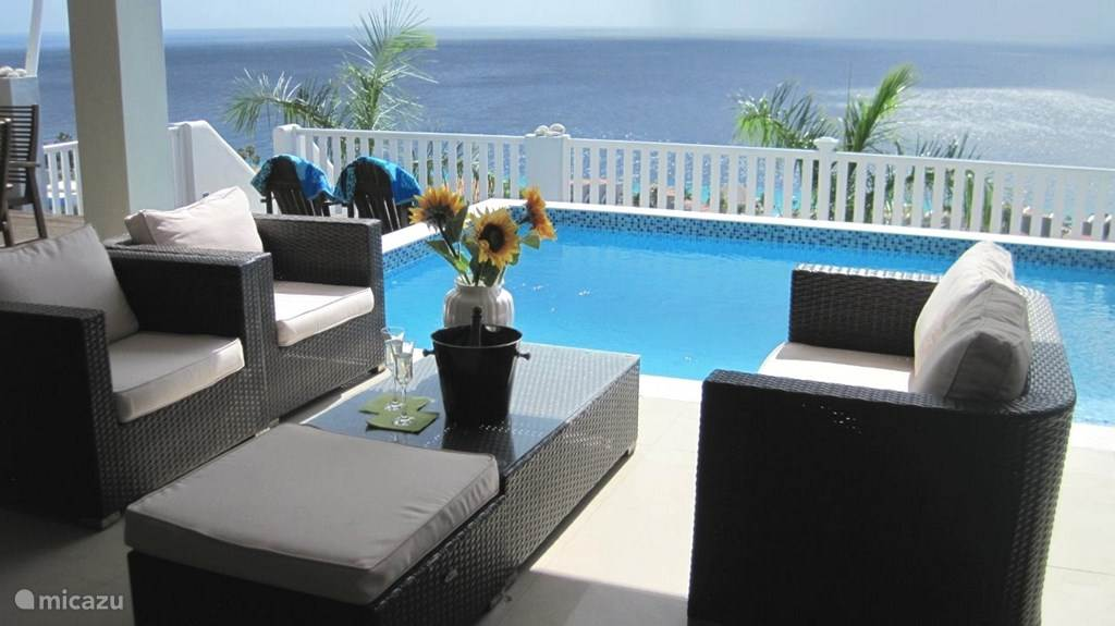 Well situated terrace on the wind near your pool.