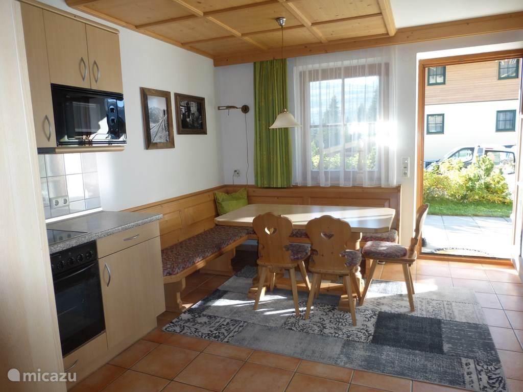 Cozy dining area with door to terrace