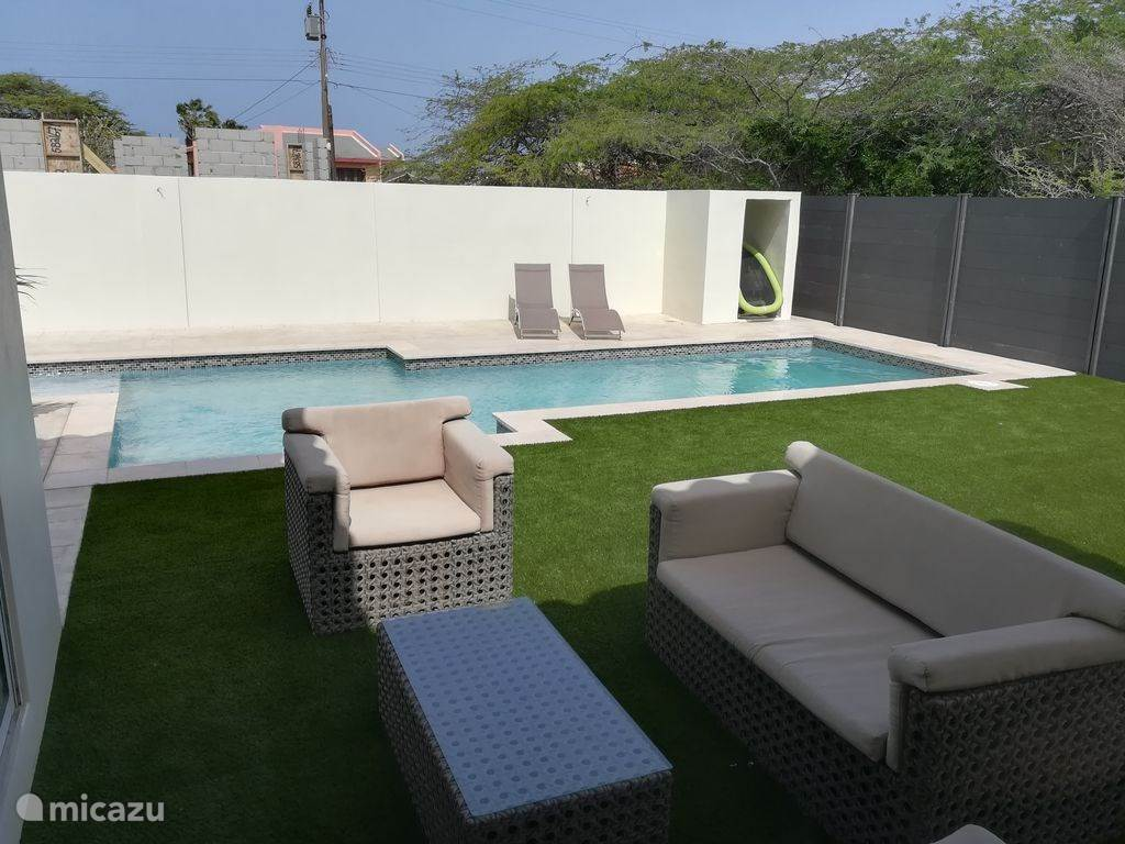 Large private pool with children's pool and sofa