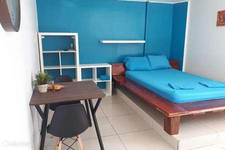 Vakantiehuis Suriname, Paramaribo, Paramaribo - studio Tosca studio met airco en zwembad