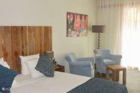 Vakantiehuis Curaçao, Curacao-Midden, Willemstad pension / guesthouse / privékamer Privèkamer op BlueBay incl. Golf