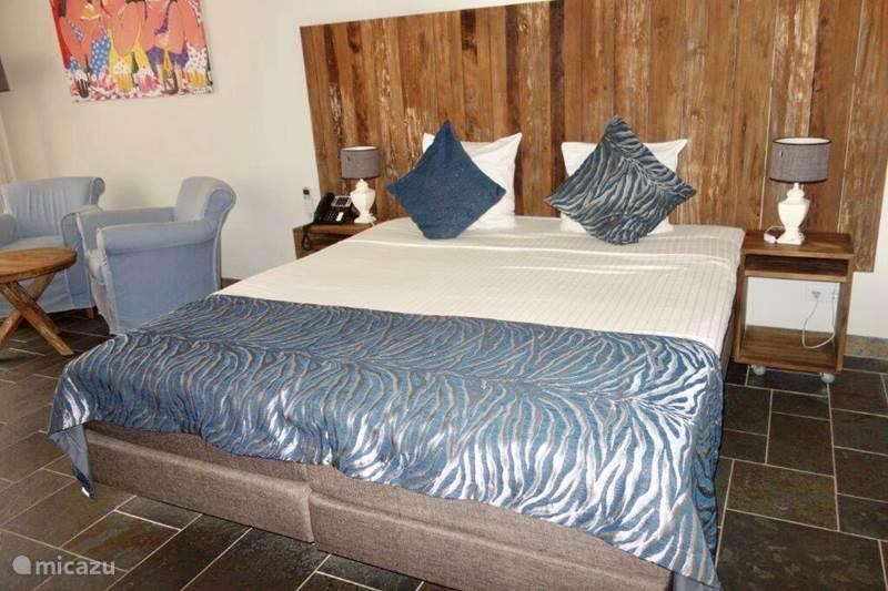 Vakantiehuis Curaçao, Curacao-Midden, Willemstad Pension / Guesthouse / Privékamer Privékamer op BlueBay incl. Golf