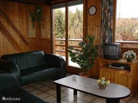 The seating in the chalet with lots of windows so very light in the house.