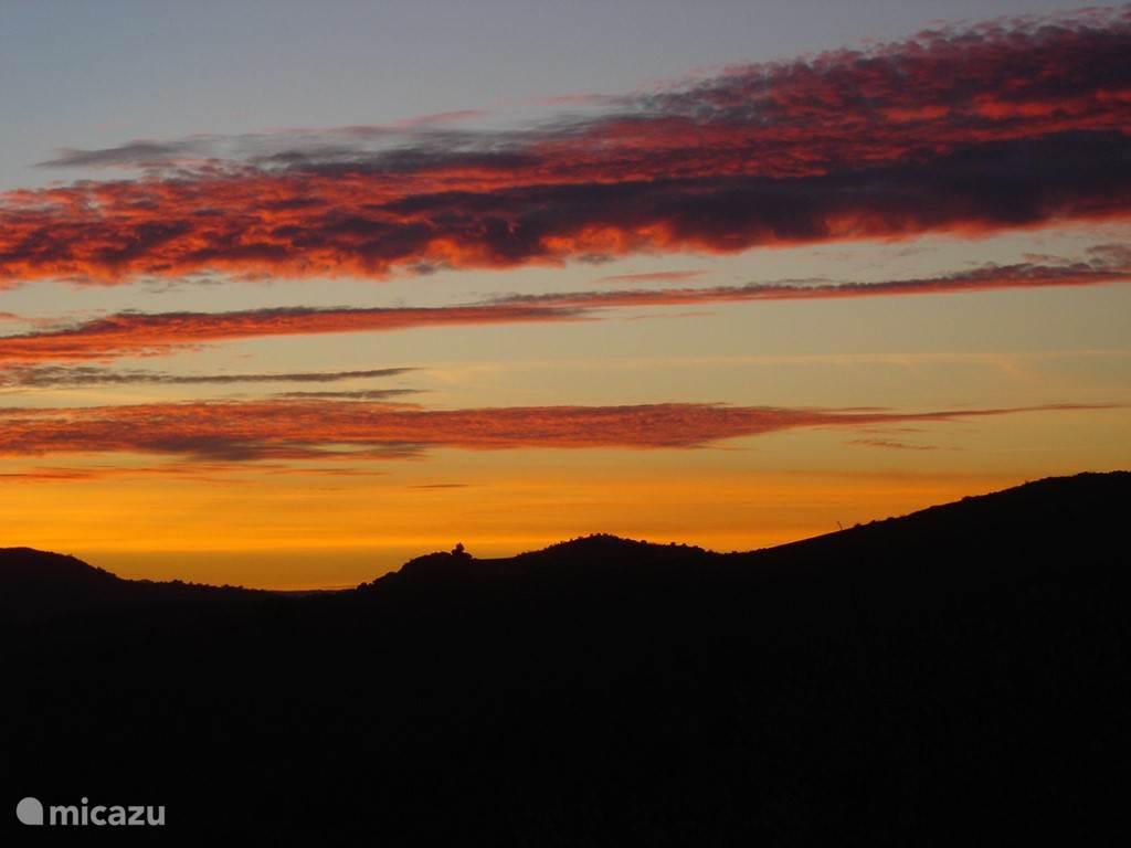 zonsondergang: alle kleuren van de regenboog ...