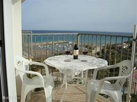 In the evening enjoy a nice glass of red wine on the terrace with stunning views over the blue Mediterranean.