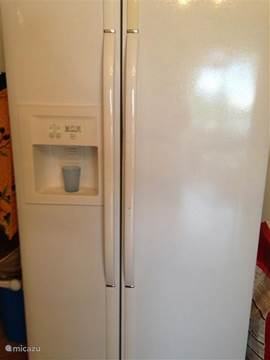 American refrigerator with water and ice dispenser.