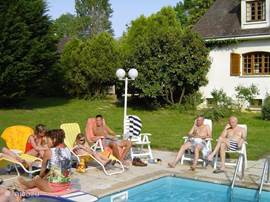 LES DESCHAMPS completely renovated in 1997 is a luxurious country estate on approx 2 acres, fully equipped, features include a pool and a room (6-10 tables) with bar. The domain is 180 km south of Paris in the heart of France. This photo is from the terrace by the pool.