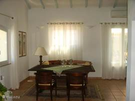 The other part of the living room, dining area, is also tasteful and spacious. The large table provides all the features as cozy conversation and / or food and beverage space.
