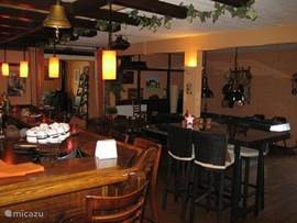 "The Maison de Maître is a cozy ""Dutch"" bar area. For a drink, chat, a game of billiards, enjoyable evening"