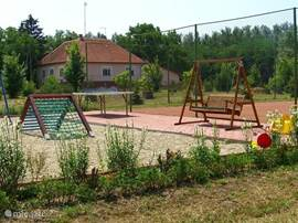 The playground and tennis court on the estate.