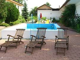 Swimming pool with sun loungers