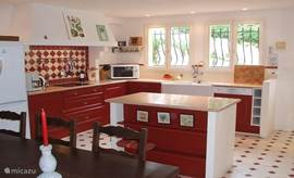 Inside Kitchen fully equipped with large dining table for 12 people.