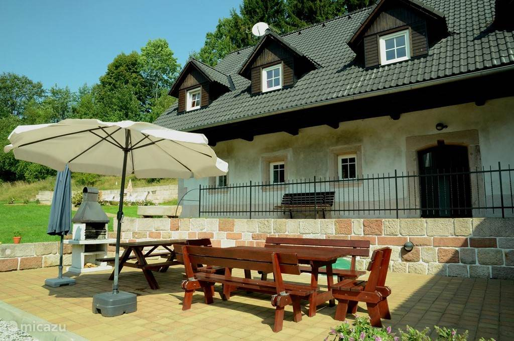 the large terrace with barbecue and garden furniture